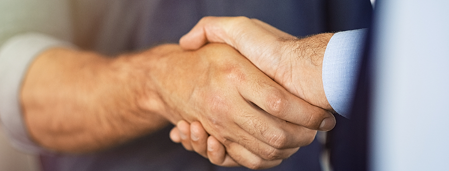 bigstock-close-up-of-friendly-handshake-343674547