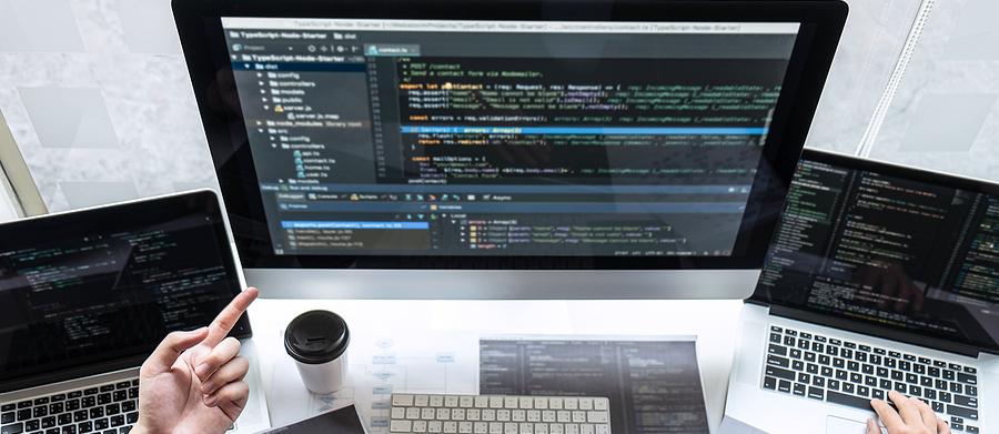bigstock-team-of-developer-programmer-w-353577962